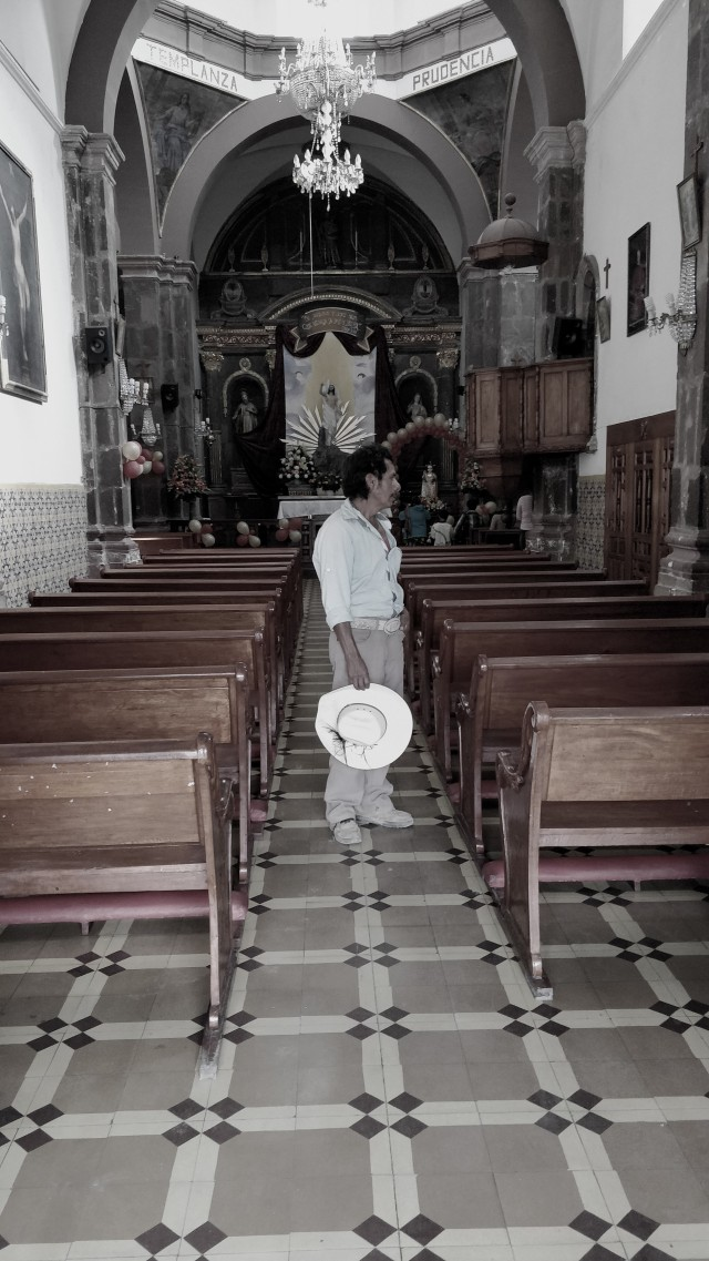 Catholic man in a church in San Miguel de Allende